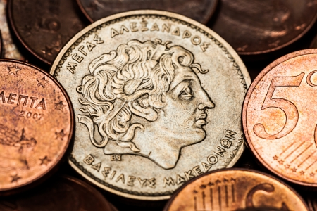 greek coins: Greek coin with portrait of Alexander the Great, , 100 drahmas of year 1992, among 5 cent Euro coins