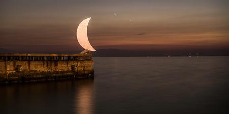 Moon Statue at Thessaloniki port, Greece Stock Photo