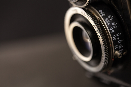 Detail of the lens of a very old camera, macro shot with copy space