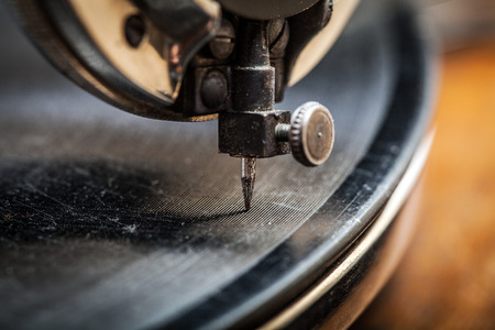 Needle of Very Old Gramophone Playing Music, macro shot Stock Photo