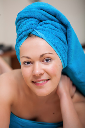 natural beauty: Pretty Young Woman with Blue Towel on Her Head After Bath
