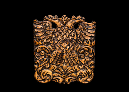 double headed eagle: Double Headed Eagle, common symbol in heraldry and vexillology. It is most commonly associated with Byzantine Empire, Holy Roman Empire, Russian Empire - on black background Stock Photo