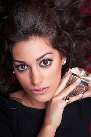 face close up: Beautiful Woman Face, holding aroma, close up