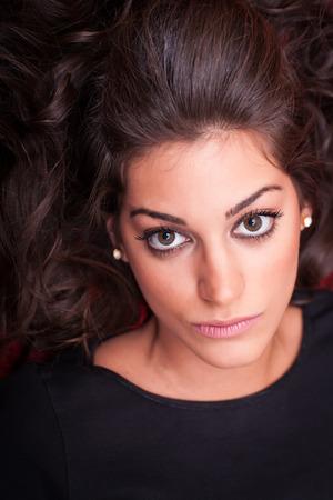 face close up: Beautiful Woman Face, looking serious,  close up