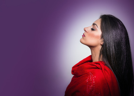 Portrait of Gorgeous Young Woman with Closed Eyes, Profile On Purple Background with copy space photo