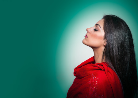 Portrait of Gorgeous Young Woman with Closed Eyes, Profile On Green Background with copy space photo