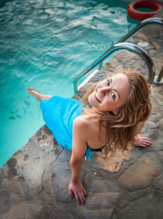 Young Beautiful Woman Enjoying Summer Vacation In Luxury Hotel Pool Stock Photo