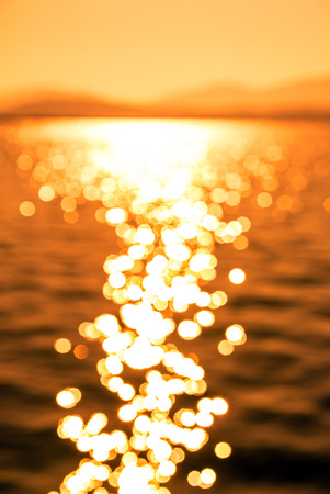 intentionally: Blurred Image of  Beautiful Sun Reflection on Sea Waves at Sunset, Intentionally Out of Focus for Background use...