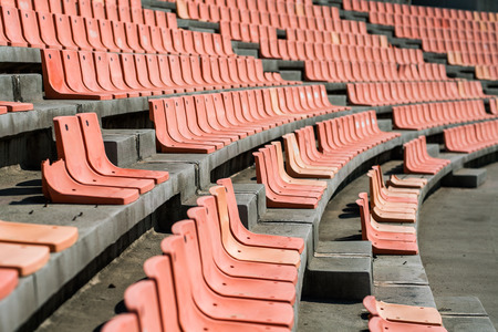 Old Weathered Plastic Seats in an old Stadium, using Shallow Depth of field Stock Photo