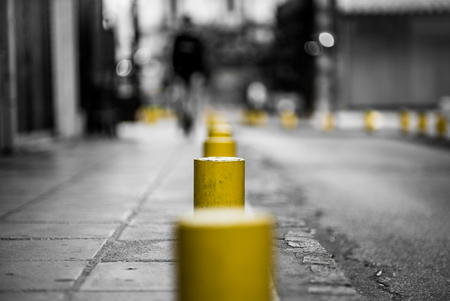Classic Style Black White and Yellow Photograph of street, using very shallow Depth of Field