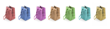 Seven Miniature Shopping Bags made of paper, on White Background, concept of shopping and gifts Stock Photo