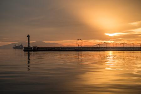 Thessaloniki Port View, Lighthouse, using tilt and shif lens, Golden Hour Stock Photo