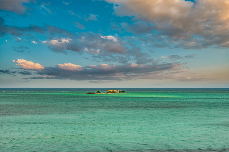 Smallest Island in the ocean, under beautiful Summer Sky