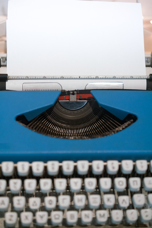 Old Typing Machine, with blank white sheet, waiting for your ideas, vertical