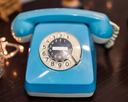 Fifty years old Telephone, in light blue color Stock Photo