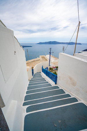 Walking on Santorini Island in Greece, one of the most beautiful travel destinations of the world.