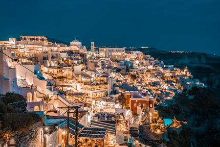 Santorini at Night, one of the most beautiful travel destinations of the world. Panoramic View at the Capital of the island, Fira