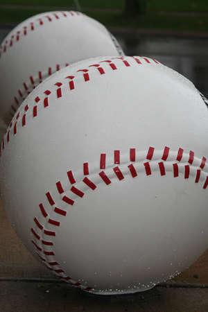 ballgame: Art shaped into baseballs outside stadium