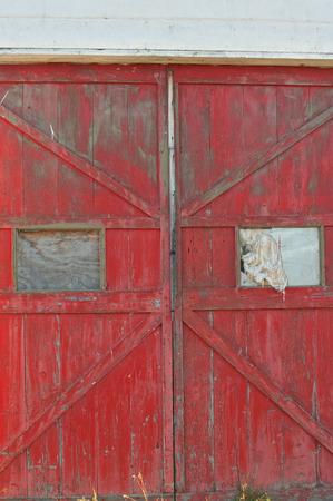 windows and doors: Old doors of abandoned building with broken windows Stock Photo