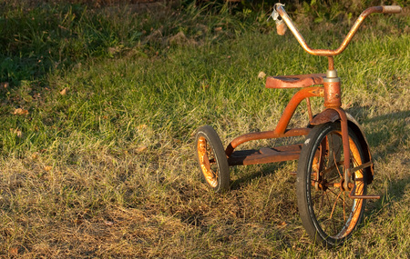 a two wheeled vehicle: A childs vintage tricycle outside at yard sale Stock Photo