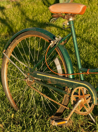pedals: Bike wheel of a vintage bicycle with vinyl seat and rusted pedals Stock Photo