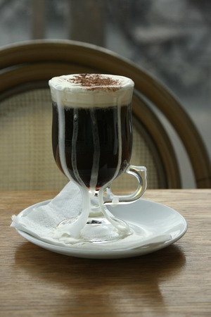 Irish coffee with whipped cream and cinnamon sprinkles