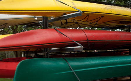 Stack of Colorful Kayaks