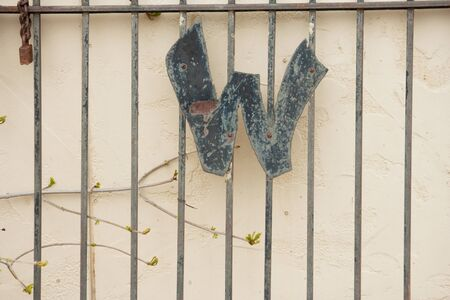 Letter W on Metal Gate