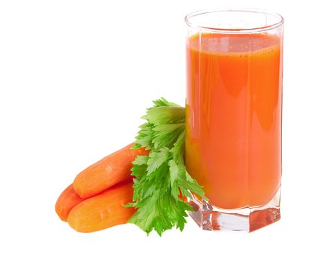 carrot juice: A glass of fresh carrot juice with celery leaves isolated Stock Photo