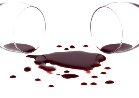 Spilled red wine isolated on white background photo