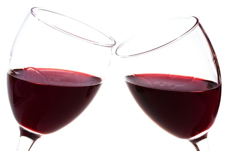 Two wineglasses with red wine isolated on white background photo