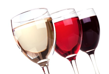 Red, rose and white wine in a wine glasses isolated on white background