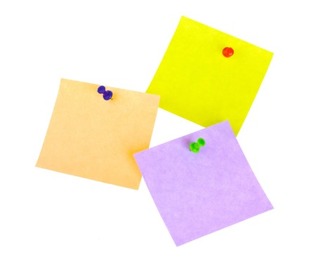 Three sticker notes with pins isolated on white background photo