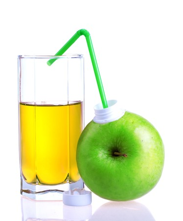 Glass of apple juice with apple package isolated on white background photo