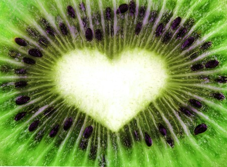 Abstract kiwi texture with heart shape photo
