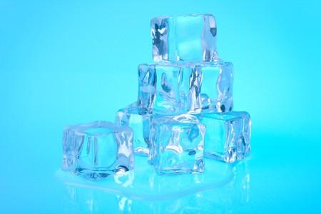 Ice cubes on blue background photo
