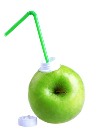 Apple with coctail straw isolated on white background