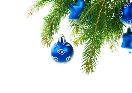 cristmas: Christmas balls on branch of fir tree isolated on white background Stock Photo