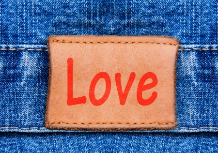 Closeup jeans leather label with text Love photo