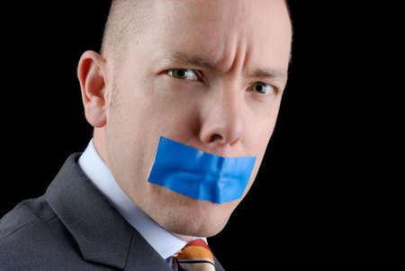 obey: Joven hombre de negocios con cinta adhesiva. Foto se hizo en un estudio