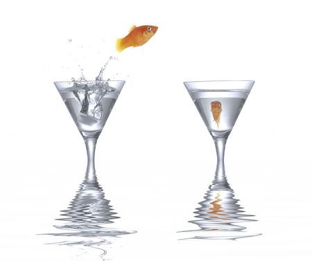 Goldfish is jumping. Picture was made in a  studio. photo