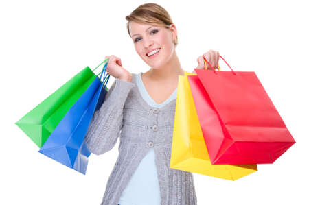 Full isolated portrait of a beautiful caucasian woman with some shopping bags photo