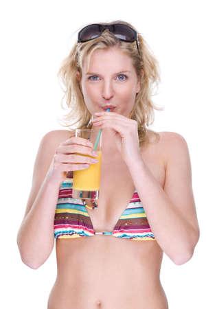 Full isolated portrait of a beautiful caucasian bikini girl with orange juice photo