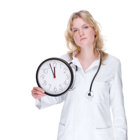 Full isolated portrait of a beautiful caucasian doctor with a clock photo
