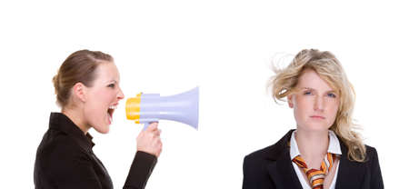 Full isolated portrait of a beautiful caucasian businesswoman shouting with a megaphone photo