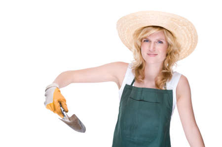 Full isolated portrait of a beautiful caucasian gardener with a small scoop photo