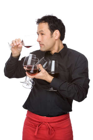 Full isolated studio picture from a man tasting some wine photo