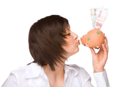 Full isolated portrait of a beautiful caucasian woman with a piggybank Stock Photo - 6000359