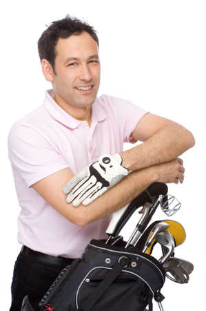Man standing with his arms crossed near his golf kit Stock Photo - 6069704