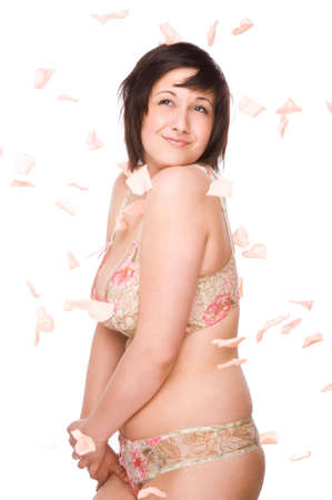 woman bra: Full isolated studio picture from a young woman with falling flowers